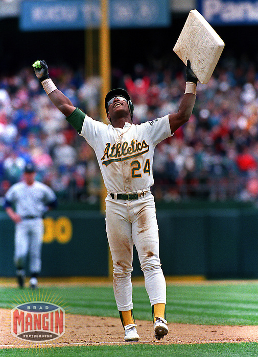Baseball: Oakland Athletics Rickey Henderson holds up stolen base number 939, making him the all-time stolen base leader during game vs New York Yankees. Oakland, CA 5/1/1991 MANDATORY CREDIT: Brad Mangin/Sports Illustrated