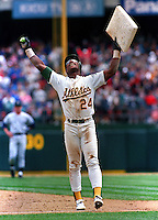 Baseball: Oakland Athletics Rickey Henderson holds up stolen base number 939, making him the all-time stolen base leader during game vs New York Yankees. Oakland, CA 5/1/1991 MANDATORY CREDIT: Brad Mangin/Sports Illustrated
