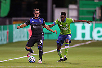 10th July 2020, Orlando, Florida, USA;  San Jose Earthquakes midfielder Vako (11) kicks the ball away from Seattle Sounders defender Kelvin Leerdam (18) during the soccer match between the Seattle Sounders and the San Jose Earthquakes on July 10, 2020, at ESPN Wide World of Sports Complex in Orlando, FL.