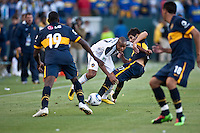 Forward Tristan Bowen (17) weaves his way Boca Junior defenders Matias Gimenez (17) and Breyner Bonilla (19) during the second half of a friendly between LA Galaxy and Boca Juniors. The game was held at the Home Depot Center in Carson, CA on May 23, 2010. The final score was LA Galaxy 1, Boca Juniors 0.