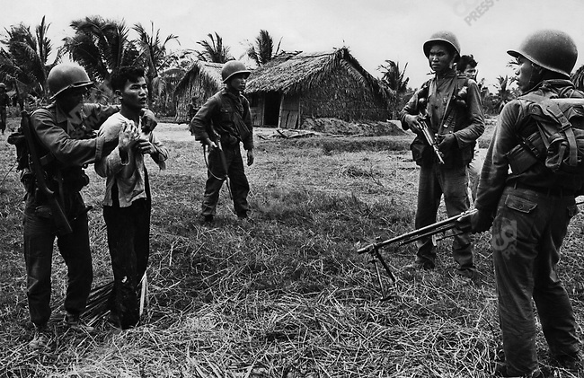 Vietcong suspects rounded up by South Vietnamese soldiers, Mekong Delta, South Vietnam, 1965.