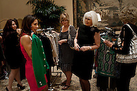 "Newport, California, July 22, 2011 - Jill Alexander (second from right) shows a green jacket to customers at The Divorcee Sale at the Pelican Hill Resort in Orange County. Organized by Jill Alexander, the sale offers luxury items most of which from uber-rich divorcees looking to unload their proverbial baggage. The event also donates 25 percent of its profits to breast cancer research...Alexander, who has actually never been married, started The Divorcee Sale this past spring after noticing a trend amongst her friends and colleagues going through divorces. ""Many women have an attachment to these things and they just want to move on,"" says Alexander. She added that the consignment shops were full and not really offering much in the way of sympathy in the situation. Alexander is different in that she visits the home of the divorcees, often with cakes and tissues, and acts as both a consignor and a confidant. ."