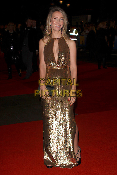 "SAM TAYLOR-WOOD.The closing gala premiere of ""Nowhere Boy"" during the The Times BFI London Film Festival, Odeon Leicester Square, London, England..October 29th, 2009 .LFF full length dress gold sequins sequined cut out away long maxi black clutch bag.CAP/AH.©Adam Houghton/Capital Pictures."