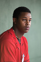 Kannapolis Intimidators starting pitcher Yency Almonte (17) sits in the dugout between innings of the game against the Delmarva Shorebirds at CMC-Northeast Stadium on June 6, 2015 in Kannapolis, North Carolina.  The Shorebirds defeated the Intimidators 7-2.  (Brian Westerholt/Four Seam Images)
