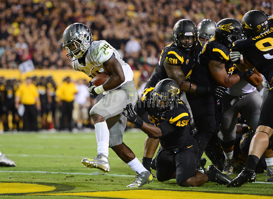 Oct. 18, 2012; Tempe, AZ, USA; Oregon Ducks running back (24) Kenjon Barner scores a touchdown in the first half against the Arizona State Sun Devils at Sun Devil Stadium. Mandatory Credit: Mark J. Rebilas-