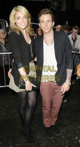 "guest & DANNY JONES of MCFLY.""Ghost The Musical"" press night, Piccadilly Theatre, Denman St., London, England..July 19th, 2011.full length white top black jacket blazer side clutch bag purse grey gray dress pink jeans denim.CAP/CAN.©Can Nguyen/Capital Pictures."