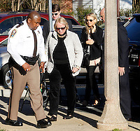 CHARLOTTESVILLE, VA - FEBRUARY 13: Yeardley Love's mother Sharon Love, middle, is escorted with family members to the Charlottesville Circuit courthouse for the George Huguely trial. Huguely was charged in the May 2010 death of his girlfriend Yeardley Love. She was a member of the Virginia women's lacrosse team. Huguely pleaded not guilty to first-degree murder. (Credit Image: © Andrew Shurtlef
