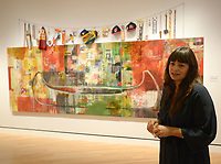 NWA Democrat-Gazette/ANDY SHUPE<br /> Independent curator Candice Hopkins speaks Thursday, Oct. 4, 2018, about a work by artist Jaune Quick-to-see Smith titled, &quot;Trade (Gifts for Trading Land With White People),&quot;during a tour of a new exhibition of artwork by Native American artists at Crystal Bridges Museum of American Art in Bentonville. The exhibition, titled &quot;Art for a New Understanding: Native Voices, 1950s to Now,&quot; opens today and runs through Jan. 7, 2019.