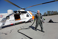 Anesthesiologist Hallstein Sørebø refueling the helicopter. Crew from Norwegian Air Force 330 squadron, flying Westland Sea King helicopter. The core mission of the squadron is SAR (search and rescue), but they also fly HEMS (Helicopter Emergency Medical Service), complementing the civilian air ambulance service.<br />