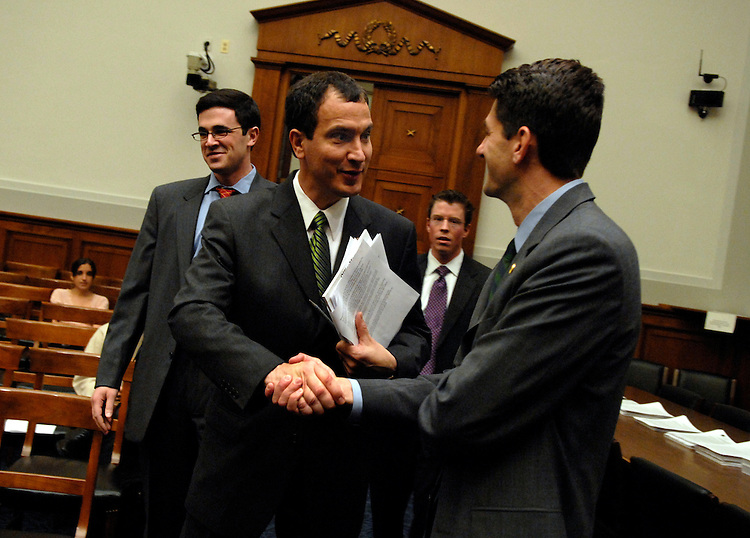 "Rep. Mark Kennedy, R-Minn., center, greets Rep. Paul Ryan, R-Wis., before a hearing of the House Judiciary Committee on ""The Constitution and the Line Item Veto."""