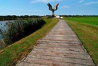 Jasenovac / Croazia.Il Campo di concentramento di Jasenovac fu il più grande campo di concentramento costruito nei Balcani durante la seconda guerra mondiale, creato dallo Stato Indipendente di Croazia, retto di fatto da Ante Paveli, alleato delle potenze dell'Asse..Si trova nei pressi dell'omonimo paese sulle rive del fiume Sava, ad un centinaio di chilometri a sud-est di Zagabria, vicino all'attuale confine croato-bosniaco..Nell'area di Jasenovac e nella vicina Stara Gradisca furono uccisi almeno 500.000 serbi, oppositori del regime, ebrei e rom..Durante il recente conflitto degli anni '90, la zona fu contesa tra serbi e croati ed il museo fu gravemente danneggiato..Sullo sfondo nella foto il grande fiore di cemento eretto dall'architetto Bogdanovic a ricordo delle vittime. .Foto Livio Senigalliesi..Jasenovac / Croatia.Jasenovac concentration camp was the largest extermination camp in the Independent State of Croatia (NDH) and occupied Yugoslavia during World War II. The camp was established by the Croatian Ustasha regime in August 1941 and dismantled in April 1945. In Jasenovac, the largest number of victims (at least 500.000) were ethnic Serbs, whom Ante Paveli considered the main racial opponents of Croatia, alongside the Jews and Roma peoples..In the picture on the background the monument erected by architect Bogdanovic..Photo Livio Senigalliesi