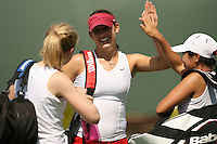 11 May 2007: Lindsay Burdette high fives Jessica Nguyen during the first round of the NCAA women's tennis tournament at the Taube Family Tennis Stadium in Stanford, CA.