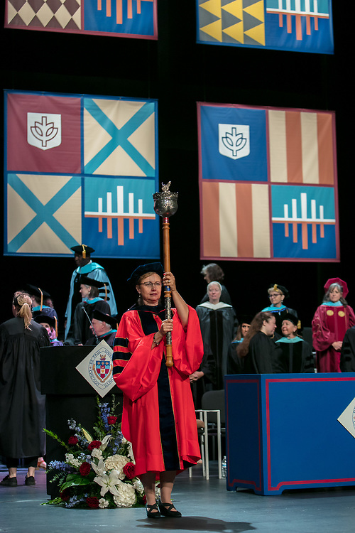 Roxanne Owens, department chair and associate professor, carries the university mace as she leads the procession Saturday, June 10, 2017, during the DePaul University College of Education commencement ceremony at the Rosemont Theatre in Rosemont, IL. (DePaul University/Jeff Carrion)