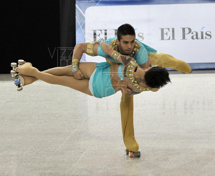 CALI - COLOMBIA - 27-07-2013: Daniele Ragazzi y Giulia Merli de Italia durante presentación en la prueba Programa Largo en Mayores Parejas en el Patinaje Artistico durante los IX Juegos Mundiales Cali, julio 27 de 2013. (Foto: VizzorImage / Luis Ramirez / Staff Daniele Ragazzi and Giulia Merli from Italy during the performance in Order Long Senior Pairs in the Artistic Skating in the IX World Games Cali July 27, 2013. (Photo: VizzorImage / Luis Ramirez / Staff.)