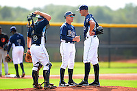 GCL Rays manager Jim Morrison (2) talks with pitcher Grayson Garvin as catcher Taylor Hawkins (6) looks on during a game against the GCL Orioles on July 20, 2013 at Charlotte Sports Complex in Port Charlotte, Florida.  GCL Orioles defeated the GCL Rays 4-1.  (Mike Janes/Four Seam Images)