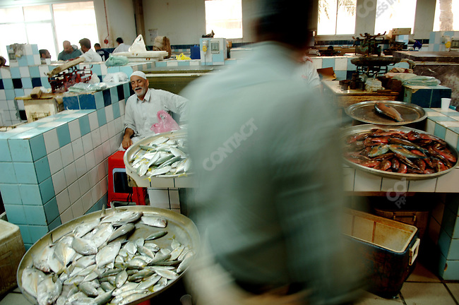 A man walked past vendors in the central fish market in Manama, the Bahraini capital, December 14, 2005.