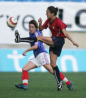 MAR 13, 2006: Faro, Portugal:  USWNT midfielder (11) Carli Lloyd clears the ball past  France midfielder (10) Camille Abily in the Algarve Cup in Faro Portugal.