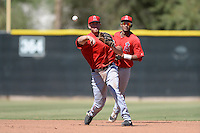 Los Angels Angels of Anaheim third baseman Cal Towey (25) throws to first as Jose Rondon backs up the play during an instructional league game against the Colorado Rockies on September 30, 2013 at Tempe Diablo Stadium Complex in Tempe, Arizona.  (Mike Janes/Four Seam Images)