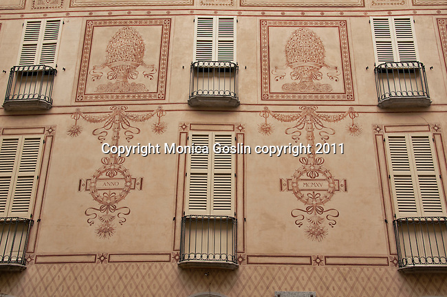 A decorated building facade in Como, Italy