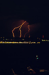 Lightning strike at nighttime West Seattle Elliott Bay