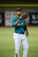 AZL Mariners left fielder DeAires Moses (8) warms up in the outfield between innings against the AZL Royals on July 29, 2017 at Peoria Stadium in Peoria, Arizona. AZL Royals defeated the AZL Mariners 11-4. (Zachary Lucy/Four Seam Images)