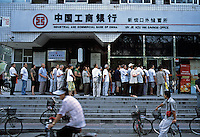 Residents line up in front of a branch of Industrial And Commercial Bank of China(ICBC) in Beijing, China..