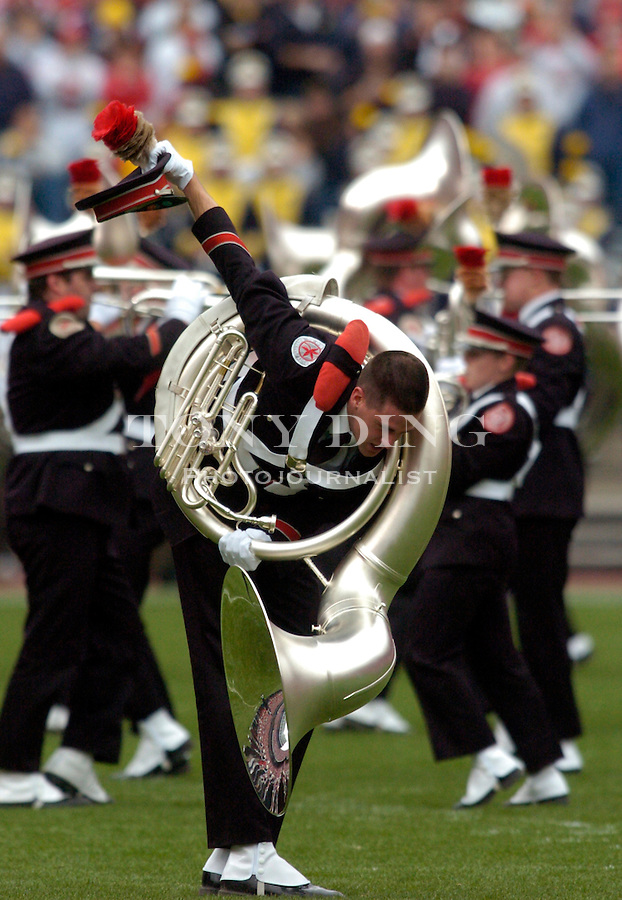 "The ""i"" tuba player of the Ohio State Marching Band bows after ""dotting the i"" of the ""Script Ohio"" formation before Michigan's 21-37 loss to Ohio State on Saturday, November 20, 2004 in Columbus, Ohio. (Photo by TONY DING/Daily)."
