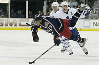 20 October 2006: Columbus Blue Jackets' Nikolai Zherdev is tripped by Toronto Maple Leafs' Bryan McCabe at Nationwide Arena in Columbus, Ohio.<br />