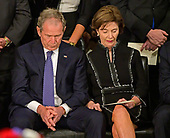 former United States President George W. Bush and former first lady Laura Bush bow their heads in prayer during the ceremony honoring former United States President George H.W. Bush, who will Lie in State in the Rotunda of the US Capitol on Monday, December 3, 2018.<br /> Credit: Ron Sachs / CNP<br /> (RESTRICTION: NO New York or New Jersey Newspapers or newspapers within a 75 mile radius of New York City)