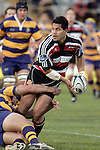 Niva Ta'auso looks to get a pass way in the tackle during the Air NZ Cup rugby game between Bay of Plenty & Counties Manukau played at Blue Chip Stadium, Mt Maunganui on 16th of September, 2006. Bay of Plenty won 38 - 11.