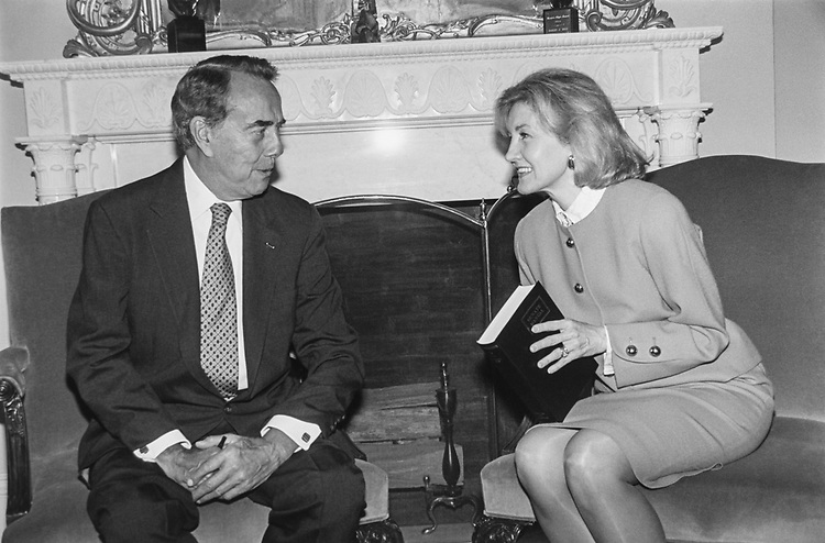 Sen. Bob Dole, R-Kans., and Senate candidate Kay Bailey Hutchison, R-Tex., in his Capitol Office.  He gives her a copy of the 'Senate Manual' on June 10, 1993. (Photo by Maureen Keating/CQ Roll Call via Getty Images)