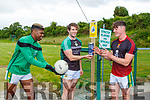 Brian Okwute, Damian O'Sullivan and Cian Gammel sanitize their hands before they take to the field on Friday evening