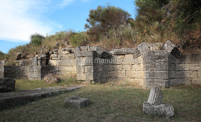 Portico B or Portico of the 17 niches, a colonnaded street built 4th century BC to link the centre in the South of the city with the agora in the North, Apollonia, Fier, Albania. The portico is 72.2m long and 10.5m wide and split into 2 bays by a central colonnade of 36 doric octagonal columns. The end wall has 17 niches which would have housed marble statues. Apollonia was an ancient Greek city in Illyria, founded in 588 BC by Greek colonists from Corfu and Corinth. It flourished in the Roman period and declined from the 3rd century AD when its harbour was silted up due to an earthquake. Picture by Manuel Cohen