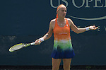 Svetlana Kuznetsova (RUS) battles against Shuai Peng (CHN) at the US Open being played at USTA Billie Jean King National Tennis Center in Flushing, NY on August 29, 2013