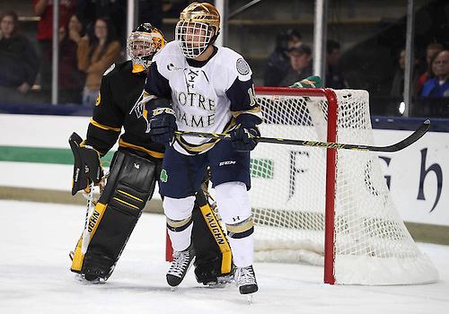 October 05, 2014:  Notre Dame center Thomas DiPauli (14) sets up in front of the net during NCAA Hockey game action between the Notre Dame Fighting Irish and the University of Waterloo at Compton Family Ice Arena in South Bend, Indiana.