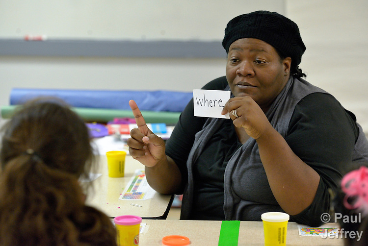Kristen Dacres works with a student with developmental disabilities in the school at Lover's Lane United Methodist Church in Dallas, Texas. Dacres is assistant director of the school.