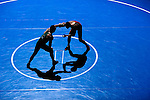 12 MAR 2011: Seth Rehn of Coe takes on Alex Martocello of York in the 184 lbs semifinals competition for third place during the Division III Men's Wrestling Championship held at the La Crosse Center in La Crosse Wisconsin. Stephen Nowland/NCAA Photos