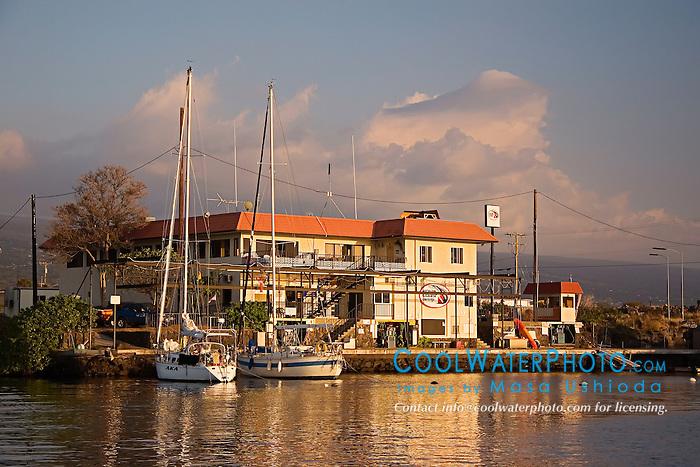The Charter Desk at the Fuel Dock and sailboats at sunset, Honokohau Harbor, Kona, Big Island, Hawaii, Pacific Ocean