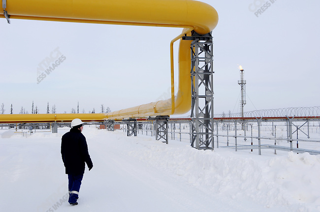 A worker walked outside one of the many parts of the base complex of the Yuzhno-Russkoye natural gas field, one of Gazprom's newest fields, supplying gas headed to Europe. Yamal-Nenets Autonomous District, Russia, February 27, 2008