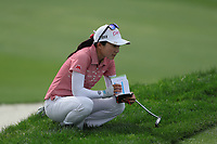 Ayako Uehara reads the green prior to putting during Round 3 at the ANA Inspiration, Mission Hills Country Club, Rancho Mirage, Calafornia, USA. {03/31/2018}.<br />