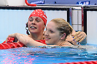 PICTURE BY ALEX BROADWAY /SWPIX.COM - 2012 London Paralympic Games - Day Seven - Swimming, Aquatic Centre, Olympic Park, London, England - 05/09/12 - Elizabeth Johnson & Charlotte Henshaw of Great Britain react after the Women's 100m Breaststroke SB6 Final.