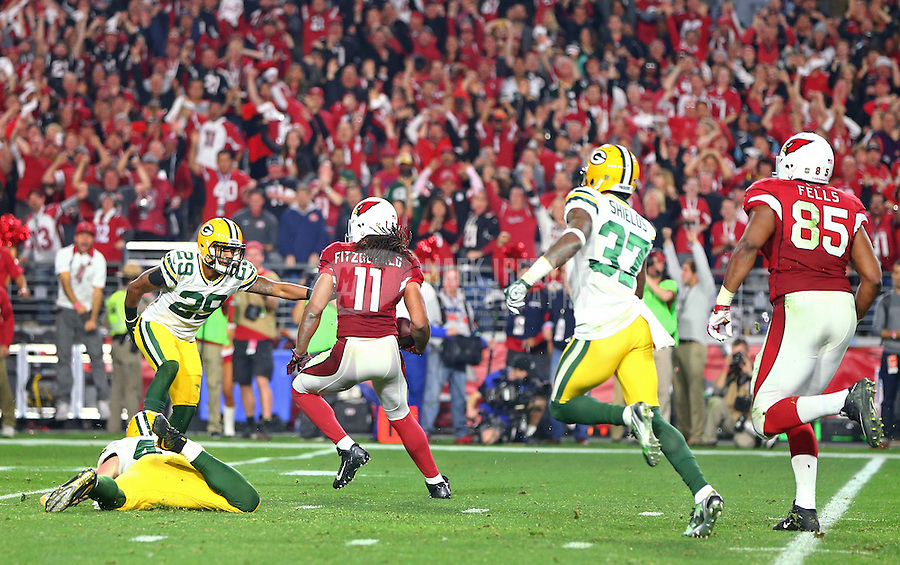 Jan 16, 2016; Glendale, AZ, USA; Arizona Cardinals wide receiver Larry Fitzgerald (11) runs the ball against Green Bay Packers cornerback Casey Hayward (29) during overtime of an NFC Divisional round playoff game at University of Phoenix Stadium. Mandatory Credit: Mark J. Rebilas-USA TODAY Sports