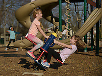 NWA Democrat-Gazette/BEN GOFF @NWABENGOFF<br /> Hollin Keeter (left), 5, and sister Olivia Keeter, 8, of Centerton get a seesaw moving Saturday, Feb. 11, 2017, while playing at Centerton City Park with their family.
