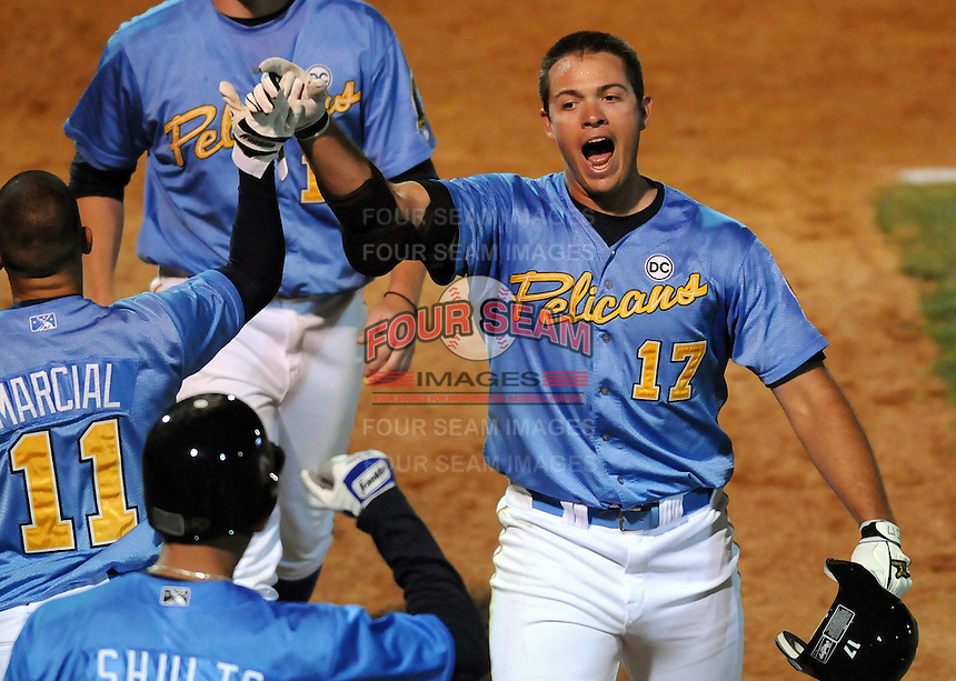 April 10, 2009: Cody Johnson (17) of the Myrtle Beach Pelicans, is congratulated by Robert Marcial and Stephen Shults after hitting the game-winning home run in the seventh inning of a game against the WIlmington Blue Rocks  at BB&T Coastal Field in Myrtle Beach, S.C. Photo by:  Tom Priddy/Four Seam Images