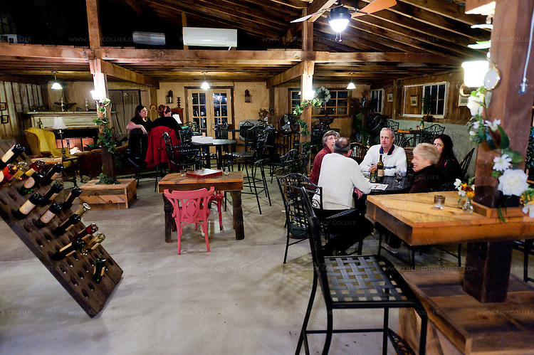 An evening crowd relaxes over their wine and snacks near closing time in the tasting room at Aspen Dale.