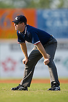 Tim Eastman handles the base umpire duties during a South Atlantic League game between the Kannapolis Intimidators and the Hickory Crawdads at L.P. Frans Stadium in Hickory, NC, Sunday, August 17, 2008.