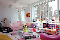 The living room is furnished with a colourful collection of sofas and armchairs all of Karim Rashid's design