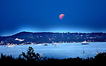 Pic shows: Boats watch Lunar eclipse over the bay that comprises the Golfe of St Tropez tonight.<br /> <br /> The eclipse has been blamed for the Lucifer heatwave and some of the forest fires that have troubled British holiday makers in the area<br /> <br /> <br /> <br /> <br /> Pic by Gavin Rodgers/Pixel 8000 Ltd