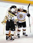 24 September 2009: Boston Bruins' defenseman Drew Fata congratulates goaltender Tim Thomas after stopping the final shootout attempt by the Montreal Canadiens at the Bell Centre in Montreal, Quebec, Canada. The Bruins edged out the Canadiens 2-1 in their pre-season matchup. Mandatory Credit: Ed Wolfstein Photo