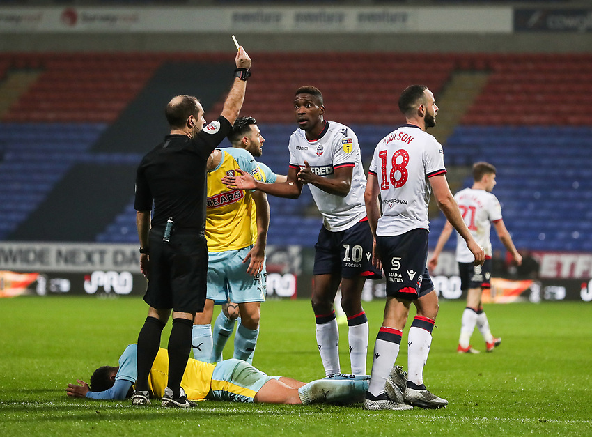 Bolton Wanderers' Marc Wilson is shown a yellow card by referee Jeremy Simpson <br /> <br /> Photographer Andrew Kearns/CameraSport<br /> <br /> The EFL Sky Bet Championship - Bolton Wanderers v Rotherham United - Wednesday 26th December 2018 - University of Bolton Stadium - Bolton<br /> <br /> World Copyright © 2018 CameraSport. All rights reserved. 43 Linden Ave. Countesthorpe. Leicester. England. LE8 5PG - Tel: +44 (0) 116 277 4147 - admin@camerasport.com - www.camerasport.com